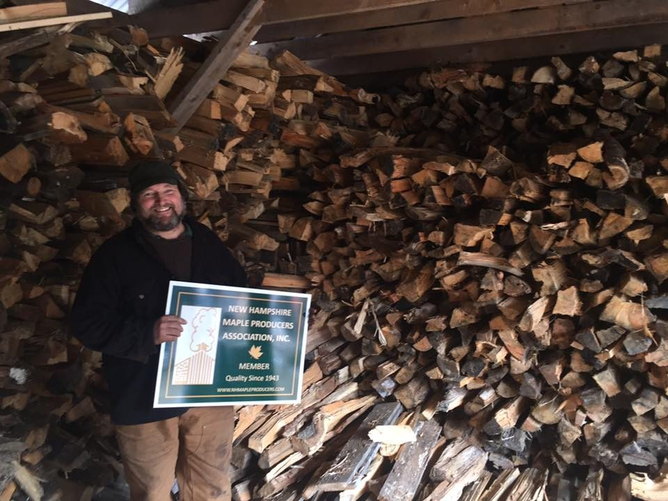 Parker Rowe of Salisbury Sugarworks with his new NHMPA sign and 30 cords ready for the next run
