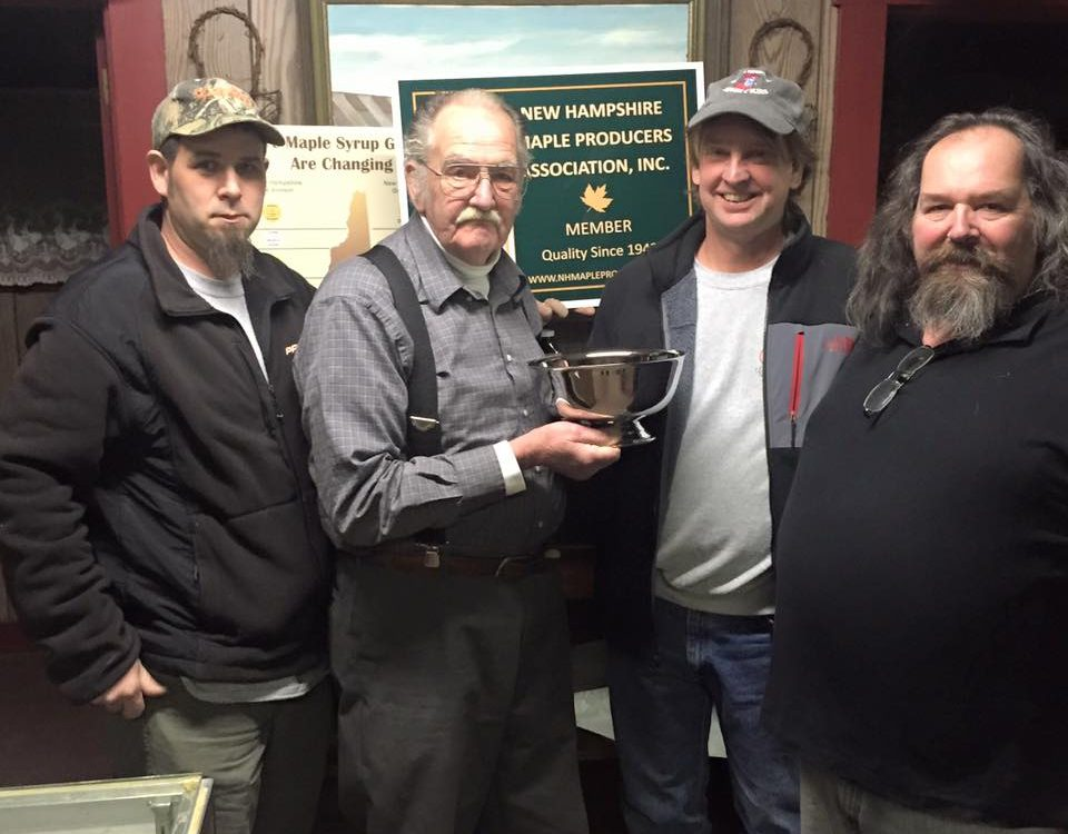 Presentation of the engraved Carlisle Cup to Bentons Sugar Shack at the regional meeting in Orford